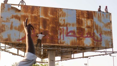 """A person writes """"Down with Bashir"""" during an April 9 demonstration in Khartoum."""