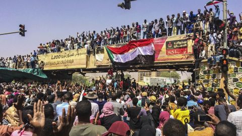 Protesters rally at a demonstration near the military headquarters, Tuesday, April 9, 2019, in the capital Khartoum, Sudan. Activists behind anti-government protests in Sudan say security forces have killed at least seven people, including a military officer, in another attempt to break up the sit-in outside the military headquarters in Khartoum. A spokeswoman for the Sudanese Professionals Association, said clashes erupted again early Tuesday between security forces and protesters who have been camping out in front of the complex in Khartoum since Saturday. (AP Photo)