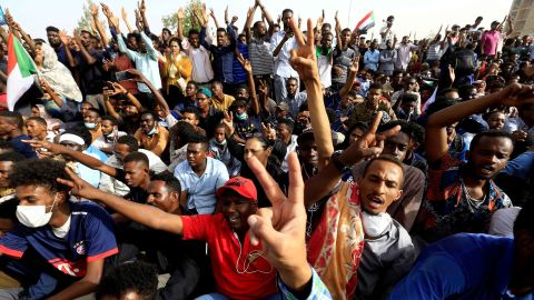 Protesters cheer outside the Defense Ministry in Khartoum on April 11. They were demanding that Bashir step down.