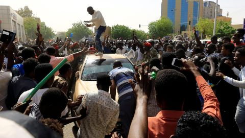 Sudanese demonstrators block the vehicle of a military officer as they chant slogans as they protest against the army's announcement that President Omar al-Bashir would be replaced by a military-led transitional council, in Khartoum, Sudan April 11, 2019. REUTERS/Stringer