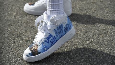 A resident of the Crenshaw neighborhood of Los Angeles wore shoes in tribute to Nipsey Hussle.