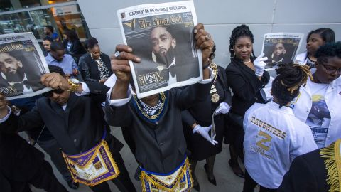 Masons attend a memorial celebration for Nipsey Hussle.