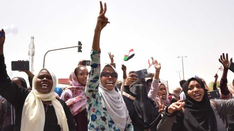 Demonstrators chant slogans as they gather in a street in central Khartoum.