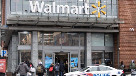 """People enter a Walmart store in Washington, DC, on March 1, 2019. - Walmart is in damage-control mode over a plan to phase out store greeters, a shift that closes off an employment niche that had frequently been taken by disabled workers. The retail giant, the biggest employer in the United States, has revamped the position of """"People Greeter"""" into """"Customer Host"""" and added new tasks, such as handling customer refunds, scanning receipts and checking shopping carts. (Photo by NICHOLAS KAMM / AFP)        (Photo credit should read NICHOLAS KAMM/AFP/Getty Images)"""