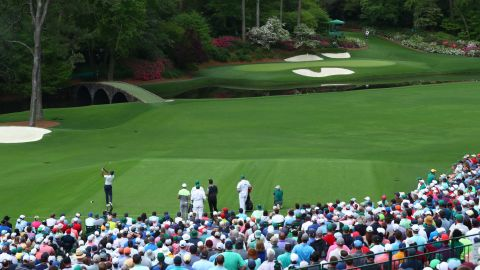 Woods hit a stunning tee shot to 12 before the siren went to suspend play because of thunderstorms.