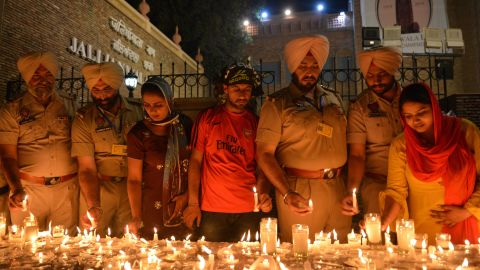 Indian Punjab Police light candles along with local residents as they pay tribute to victims of the Jallianwala Bagh massacre on the eve of the 100th anniversary.