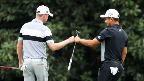 Alongside Woods chasing leader Francesco Molinari were Justin Harding (left) of South Africa and American Xander Schauffele.