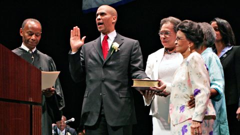 Booker takes the oath of office in July 2006. Next to him, holding the Bible, is his mother, Carolyn. Also holding the Bible in the foreground is Booker's grandmother, Adeline Jordan.