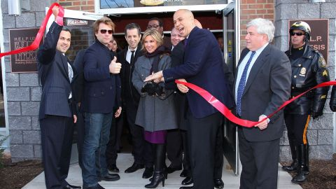 Booker helps cut the ribbon at the opening of affordable housing in Newark that was funded through Jon Bon Jovi's JBJ Soul Foundation in December 2009.