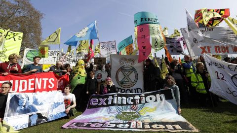 Demonstrators gather during a climate protest in Parliament Square in London, Monday, April 15, 2019. Extinction Rebellion have organised a nationwide week of action, they are calling for a full-scale Rebellion to demand decisive action from governments on climate change and ecological collapse. They plan to engage in acts of non-violent civil disobedience against governments in capital cities around the world. (AP Photo/Kirsty Wigglesworth)