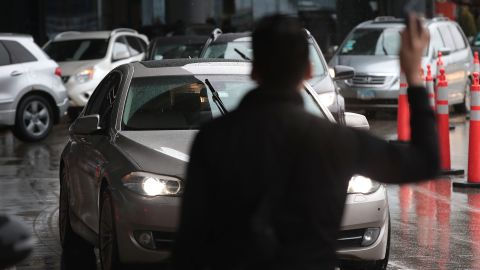 CHICAGO, ILLINOIS - APRIL 10: Travelers wait for ride share vehicles at O'Hare Airport on April 10, 2019 in Chicago, Illinois. In response to the death of 21-year-old University of South Carolina student Samantha Josephson, the South Carolina House has approved a bill that would require Uber, Lyft and other ride sharing vehicles to have illuminated signs. Josephson was killed after climbing into a vehicle that she thought was her Uber ride.  (Photo by Scott Olson/Getty Images)