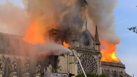TOPSHOT - Flames and smoke are seen billowing from the roof at Notre-Dame Cathedral in Paris on April 15, 2019. - A fire broke out at the landmark Notre-Dame Cathedral in central Paris, potentially involving renovation works being carried out at the site, the fire service said.Images posted on social media showed flames and huge clouds of smoke billowing above the roof of the gothic cathedral, the most visited historic monument in Europe. (Photo by Patrick ANIDJAR / AFP)        (Photo credit should read PATRICK ANIDJAR/AFP/Getty Images)
