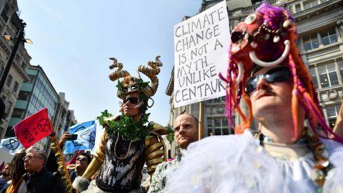 Demonstrators wear costumes at Oxford Circus.