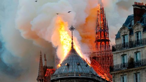 TOPSHOT - Smoke and flames rise during a fire at the landmark Notre-Dame Cathedral in central Paris on April 15, 2019, potentially involving renovation works being carried out at the site, the fire service said. (Photo by FRANCOIS GUILLOT / AFP)