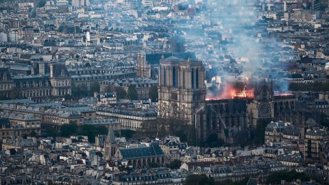 Smoke and flames rise during a fire at the landmark Notre-Dame Cathedral in central Paris on April 15, 2019, potentially involving renovation works being carried out at the site, the fire service said. - A major fire broke out at the landmark Notre-Dame Cathedral in central Paris sending flames and huge clouds of grey smoke billowing into the sky, the fire service said. The flames and smoke plumed from the spire and roof of the gothic cathedral, visited by millions of people a year, where renovations are currently underway. (Photo by Philippe LOPEZ / AFP)        (Photo credit should read PHILIPPE LOPEZ/AFP/Getty Images)