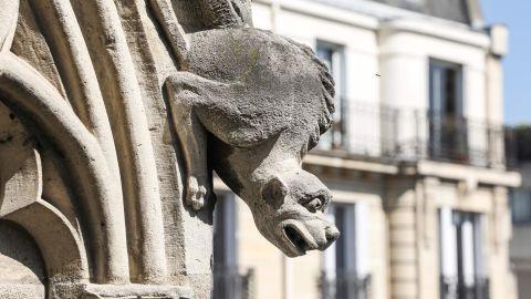 A gargoyle adorns the exterior of Notre Dame Cathedral.