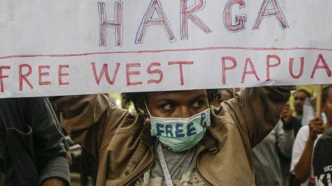 A West Papuan activist holds a banner demanding independence.