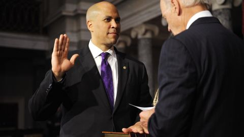 Booker takes the oath of office from Vice President Joe Biden during a ceremonial swearing-in at the US Capitol.