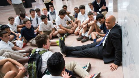 Booker meets with eighth-graders during their end-of-year trip to Washington in May 2016.