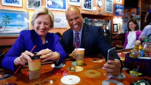 Booker campaigns with Democratic presidential candidate Hillary Clinton at a cafe in Newark in June 2016.