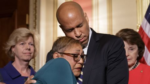 During a news conference in June 2016, Booker embraces the Rev. Sharon Risher, a clinical trauma chaplain who lost her mother and two cousins in a church shooting in Charleston, South Carolina. Democratic senators were calling for gun-control legislation after a mass shooting at an Orlando nightclub.