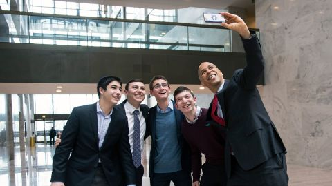 Booker poses for a photo with a group of visitors at the Hart Senate Office Building in Washington in January 2019.