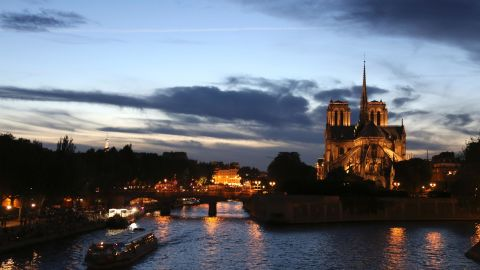 This picture taken on September 3, 2016 shows tourists boats cruising on the Seine river along the Notre Dame Cathedral at sunset in Paris. / AFP / LUDOVIC MARIN        (Photo credit should read LUDOVIC MARIN/AFP/Getty Images)