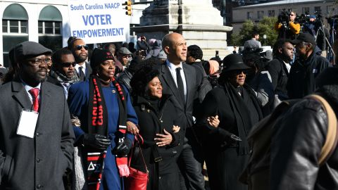 Booker walks with NAACP leaders during a Martin Luther King Jr. Day march in Columbia, South Carolina, in January 2019.