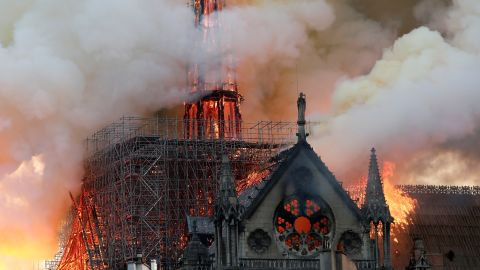 Smoke billows from the cathedral's roof and spire during the fire.