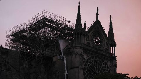 Notre Dame is seen at sunrise as firefighters continue to work at the cathedral on the morning of April 16.