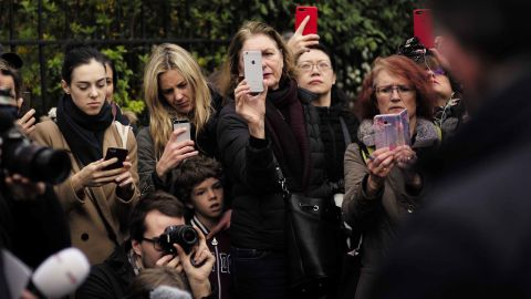 People take photos at the scene on April 16, 2019.