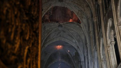 The interior of the cathedral roof is seen smoldering.