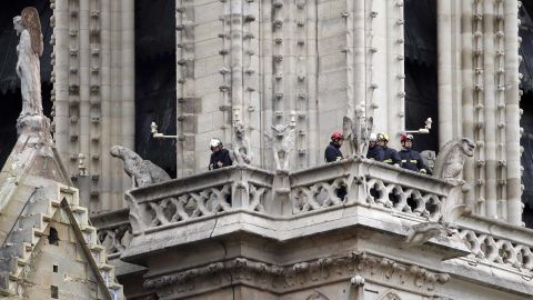 Members of the fire department inspect the cathedral.