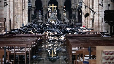 Debris from the roof lies near the altar inside Notre Dame Cathedral in Paris on April 16, 2019, the day after the devastating fire.