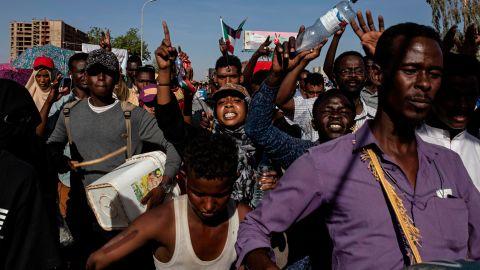 Demonstrators rally near the military headquarters in Khartoum on April 15.