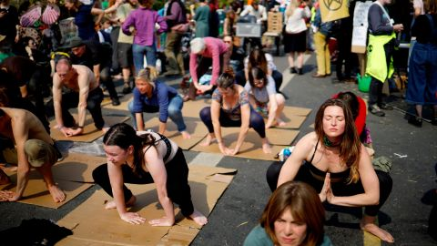 Climate change protestors practice yoga on Waterloo Bridge in central London on April 17.