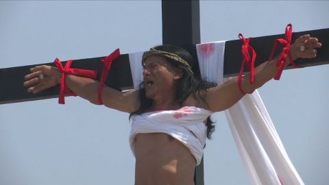 Ruben Enaje grimaces in pain during his cruxifixion in San Pedro Cutud, Philippines.
