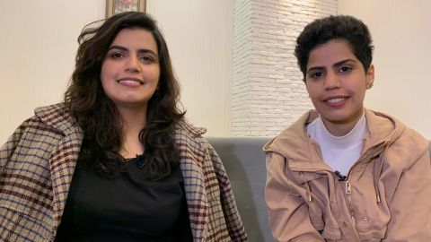 Maha Zayed al-Subaie 28, left, and her sister, 25-year-old Wafa, are photographed on April 18 during an interview with CNN, after applying for asylum in Georgia.