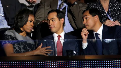 First lady Michelle Obama speaks with Julian Castro, center, and Joaquin Castro at the Democratic National Convention.
