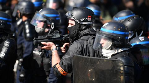 Officers counter protesters in Paris on April 20, 2019.