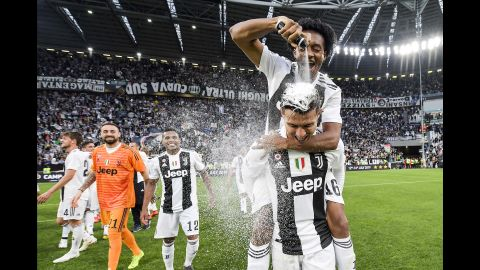 """Cristiano Ronaldo celebrates with Juan Cuadrado after winning the Italian championship Serie A match between Juventus and ACF Fiorentina on Saturday, April 20, in Turin, Italy. The win makes Ronaldo the <a href=""""https://www.cnn.com/2019/04/20/football/juventus-champions-serie-a-cristiano-ronaldo-spt-intl/index.html"""" target=""""_blank"""">first player to win</a> the Premier League, La Liga and Serie A."""