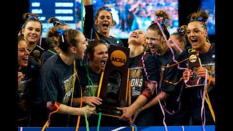 The team from the University of Oklahoma celebrates after winning the NCAA college women's gymnastics championship on Saturday, April 20, in Fort Worth, Texas.