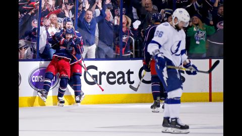 """Artemi Panarin and Josh Anderson of the Columbus Blue Jackets celebrate after scoring an empty net goal in Game 4 of the First Round of the 2019 NHL Stanley Cup Playoffs against the Tampa Bay Lightning on Tuesday, April 16, in Columbus, Ohio. Columbus defeated Tampa Bay 7-3 to win the series 4-0. It was the <a href=""""https://bleacherreport.com/articles/2831701-blue-jackets-win-1st-ever-playoff-series-with-historic-sweep-of-lightning"""" target=""""_blank"""" target=""""_blank"""">first ever playoff series win</a> for the Blue Jackets franchise."""