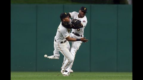 Pittsburgh Pirates shortstop Erik Gonzalez, left, and center fielder Starling Marte collide while chasing a fly ball against the San Francisco Giants on Friday, April 19, in Pittsburgh.