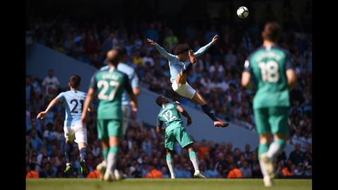 Manchester City's Leroy Sane jumps for the ball over Tottenham Hotspur's Victor Wanyama during the English Premier League football match on Saturday, April 20, in Manchester.