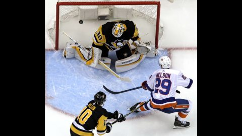 """Brock Nelson of the New York Islanders scores on Pittsburgh Penguins goaltender Matt Murray during the first period of Game 4 of their NHL first-round playoff series in Pittsburgh on Tuesday, April 16. The <a href=""""https://bleacherreport.com/articles/2831685-islanders-complete-series-sweep-of-sidney-crosby-penguins-with-3-1-game-4-win"""" target=""""_blank"""" target=""""_blank"""">Islanders won the game 3-1</a>, sweeping the Penguins to advance to the second round."""