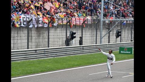 British driver Lewis Hamilton waves to fans after winning the Formula One Chinese Grand prix in Shanghai on Sunday, April 14.