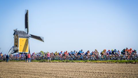 Cyclists ride past a windmill in Maastricht, Netherlands, during the Amstel Gold Cycling Race on Sunday, April 21.
