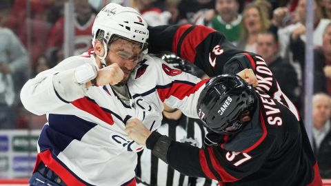 """Alex Ovechkin of the Washington Capitals, left, and Andrei Svechnikov of the Carolina Hurricanes fight during Game 3 of their first-round playoff series on Monday, April 15 at PNC Arena in Raleigh, North Carolina. Ovechkin knocked out Skevchnikov during the fight, who had to leave the game and <a href=""""https://bleacherreport.com/articles/2831518-video-capitals-alex-ovechkin-knocks-out-hurricanes-andrei-svechnikov-in-fight"""" target=""""_blank"""" target=""""_blank"""">enter the NHL's concussion protocol</a>."""