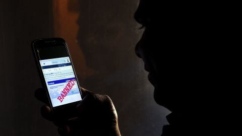 A Sri Lankan man mobile phone user shows an image on Twitter showing that the Facebook site had been blocked